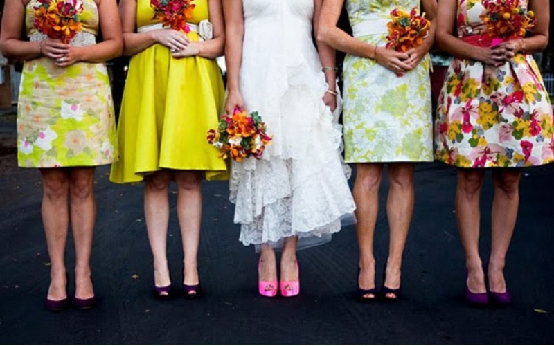 mismatched floral and bright bridesmaid dresses are nice for a colorful summer or spring wedding