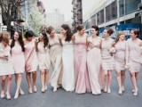 mismatched blush and neutral bridesmaid dresses of knee length are nice and chic for a neutral wedding