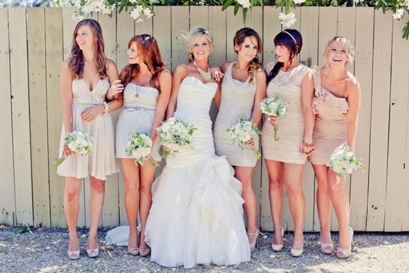 short mismatched blush and neutral bridesmaid dresses are nice for a spring or summer wedding