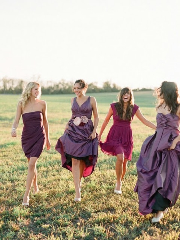 purple and fuchsia bridesmaid dresses of various lengths and designs are nice for a sumptuous fall wedding