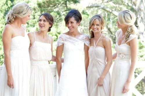 mismatched white bridesmaid dresses of various designs are chic and trendy, for spring and summer nuptials