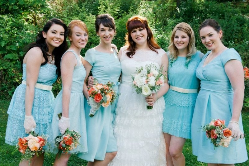 mismatched short light blue bridesmaid dresses with sashes are cool and chic for a spring or summer wedding