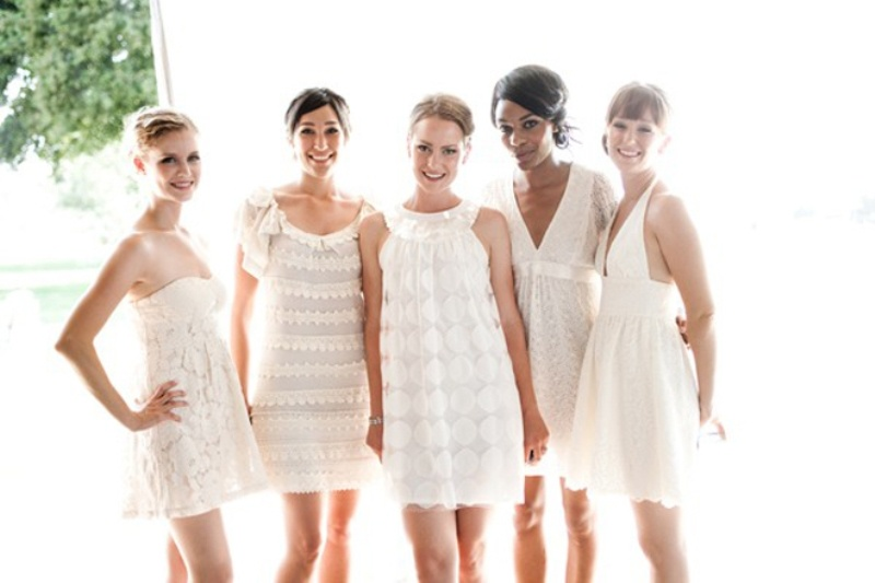 mismatching short white bridesmaid dresses are very trendy and cool   white bridal parties are very edgy