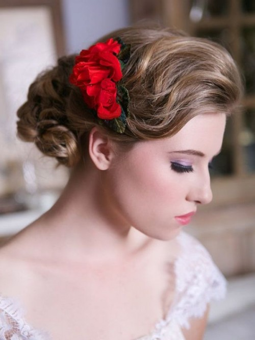 a red flower headpiece with leaves is a nice accessory to accent your winter bridal hairstyle