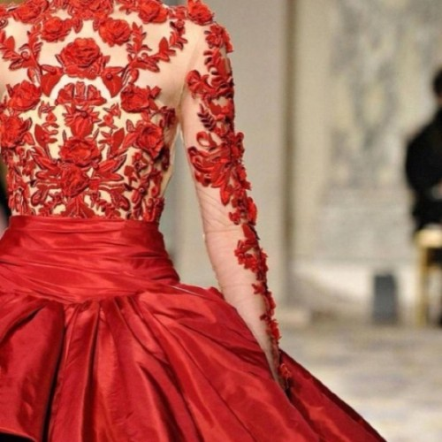 a red wedding ballgown of an illusion lace bodice and a full shiny skirt is a stunning solution for a winter or Christmas bride
