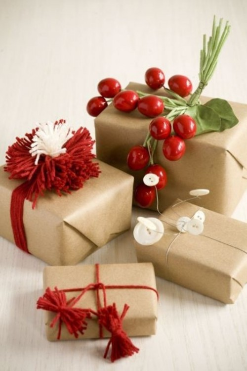 winter wedding favors in kraft paper, with berries, pompoms and leaves for a winter or Christmas wedding