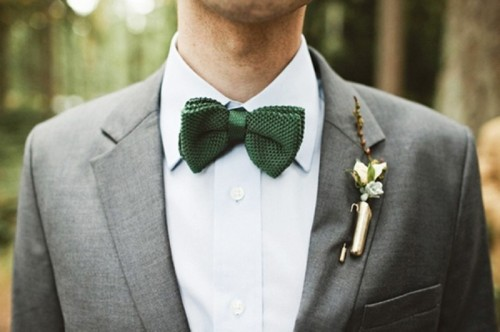 accessorize your look with a green bow tie and a pretty boutonniere for a winter wedding