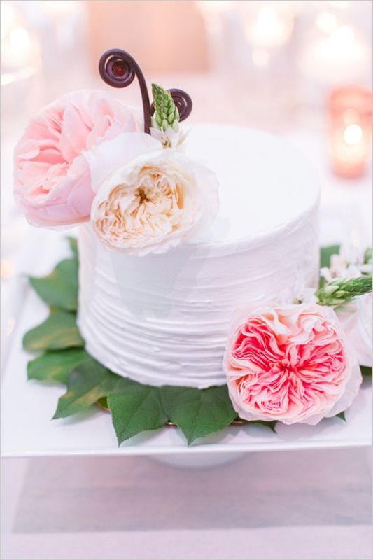 a textural one tier wedding cake topped with fresh and bright blooms is a beautiful idea for a spring or summer wedding
