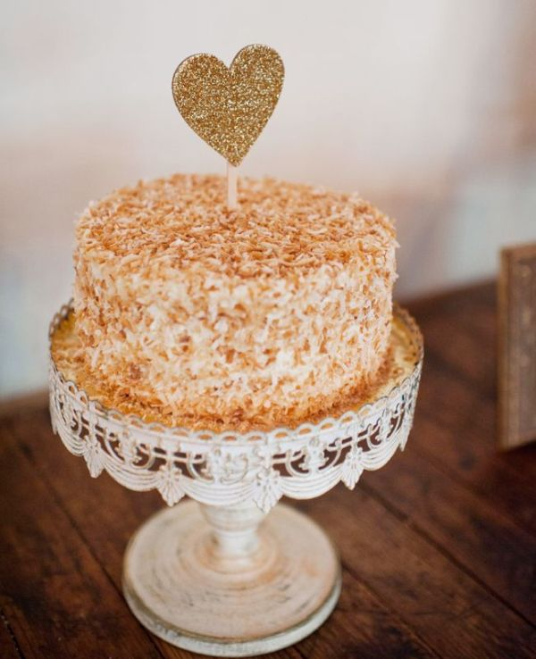 a mille feuille wedding cake topped with a glitter heart is a fresh take on the traditional dessert