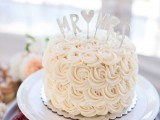 a white textural rose buttercream with Mr and Mrs toppers is a classic option to try
