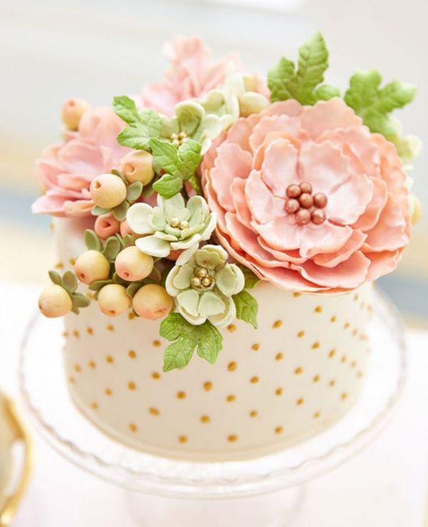 a polka dot one tier wedding cake with sugar blooms and even sugar succulents and berries on top is a playful idea
