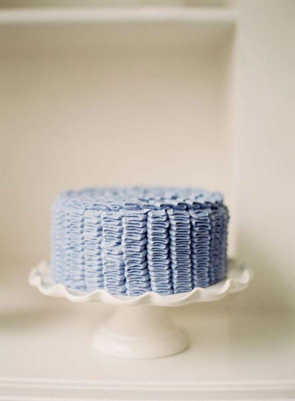 a blue buttercream pattern wedding cake is ideal for a seaside or beach wedding
