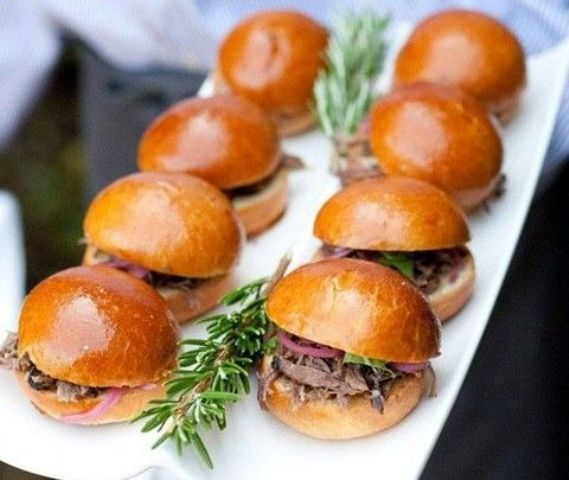 mini sliders filled with meat or chicken and greenery are a great idea for fast food lovers
