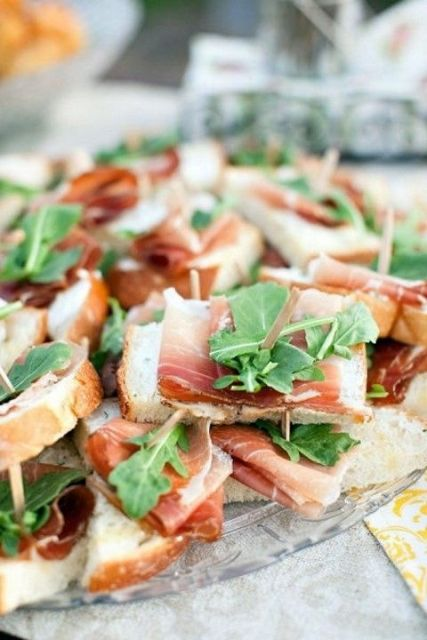 mini sandwiches with proschiutto and arugula are a delicious appetizer idea for any wedding season