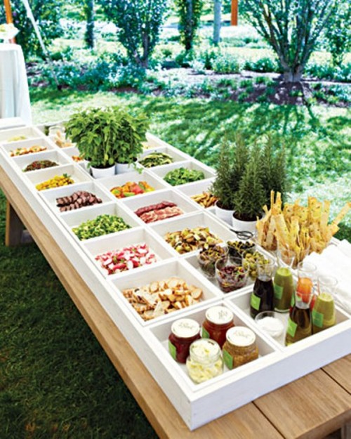 a wedding fresh salad bar with various types of fresh veggies with various sauces and dips and Fresh fries