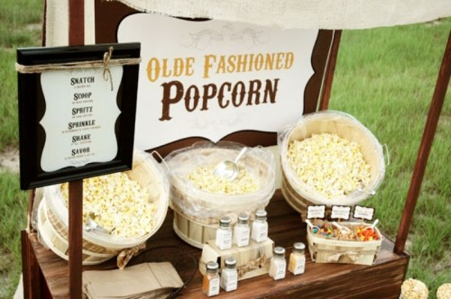 a simple and retro popcorn bar styled with various toppings is a cool idea for any wedding, not only a retro one