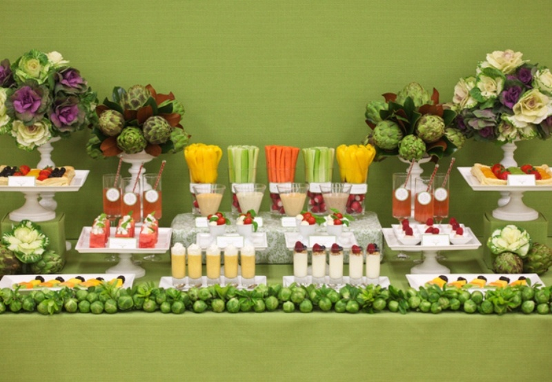 a fresh veggies and juice bar, with fruits tarts, veggie and flower arrangements and edible decor