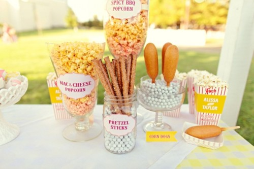 pop corn and dog corn plus pretzel bar in big jars and boxes is a cool idea of a wedding food bar