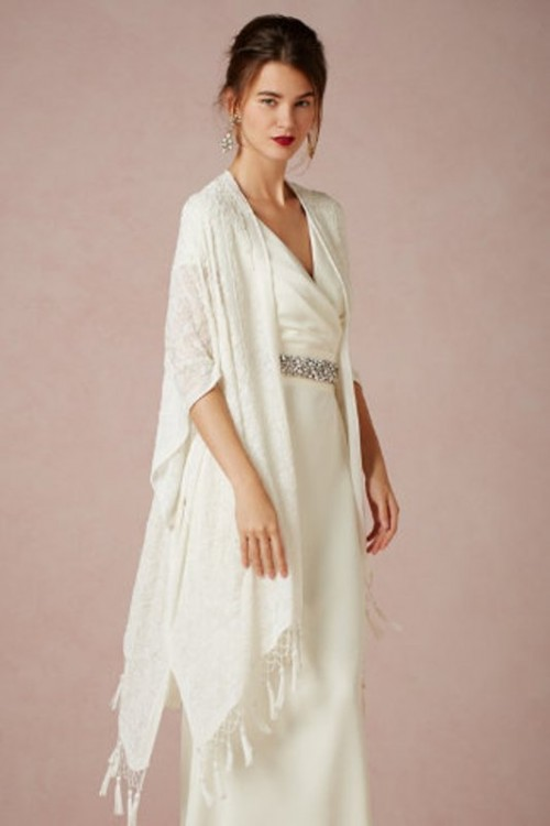 a beautiful long lace and fringe coverup is a timeless idea for a bride who wants a romantic touch to her look