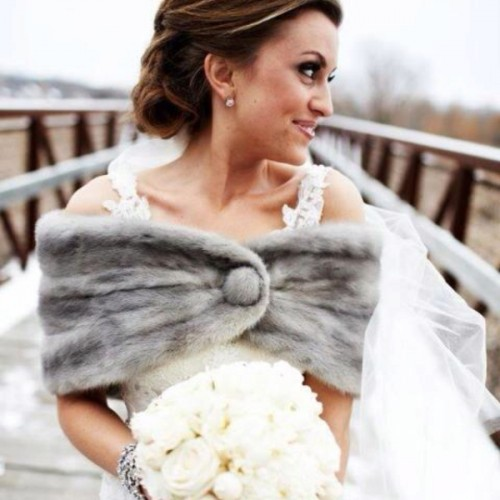 a grey faux fur coverup with a button is a great piece to pair it with a sleeveless or strapless wedding dress