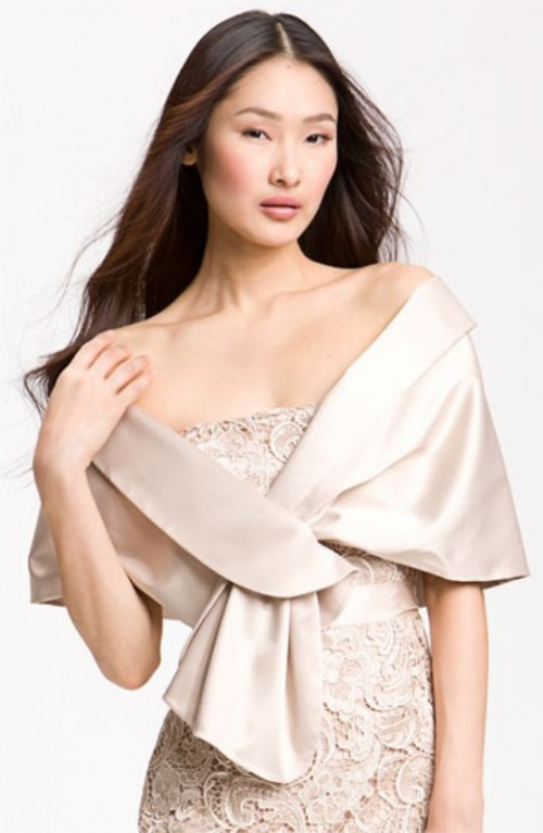 a neutral plain coverup of shiny fabric is a cool idea for a bride who loves vintage