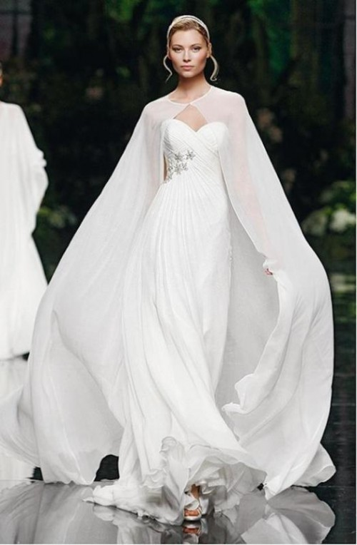 a sheer plain white wedding capelet with a train is a trendy and modern idea for a fall or winter bride