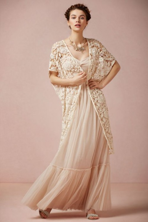 a long sleeveless lace coverup in a creamy shade is a boho touch to your fall bridal look