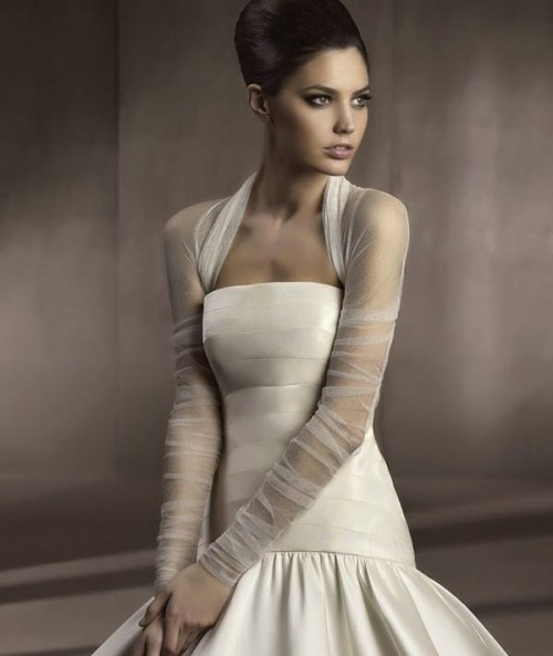 a sheer white coverup with long sleeves is a timeless idea to pair with your wedding dress