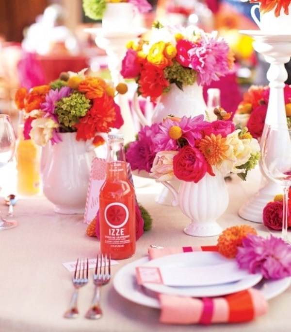 a super bold wedding tablescape with fuchsia, red and yellow blooms   floral arrangements, lemonade and colorful linens