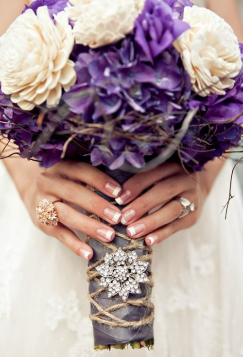 a bouquet wrap of ribbon, with twine, a large rhinestone brooch will make your bouquet more rustic yet modern glam