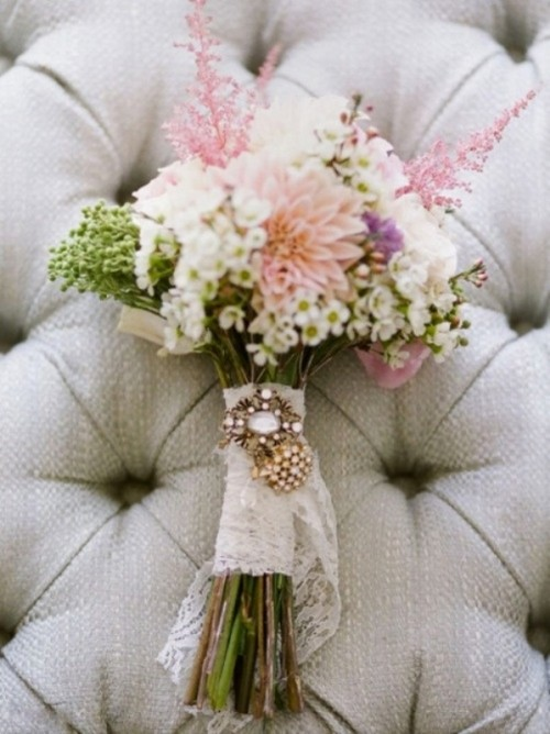 a lace wrap with a rhinestone brooch is an amazing accent for a vintage-inspired wedding bouquet