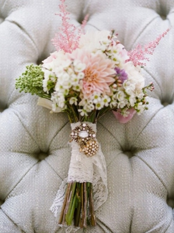 a lace wrap with a rhinestone brooch is an amazing accent for a vintage inspired wedding bouquet