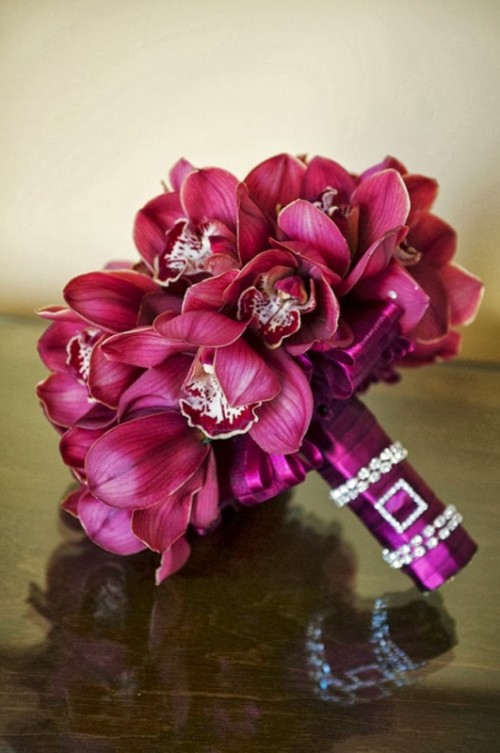 a bold ribbon wrap with rhinestone accents perfectly fits the bold wedding bouquet itself adding a bit of glam