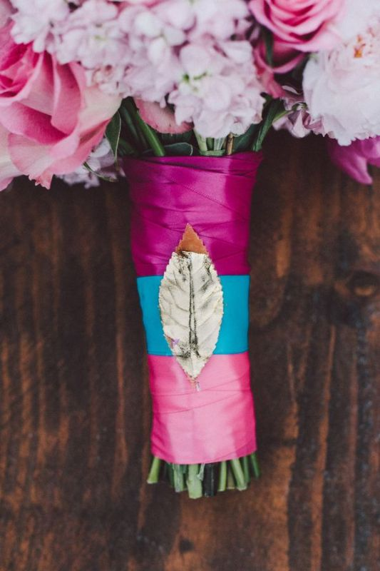 a pink and blue bouquet wrap with a metallic leaf accent is amazing for nature lovers and a colorful wedding