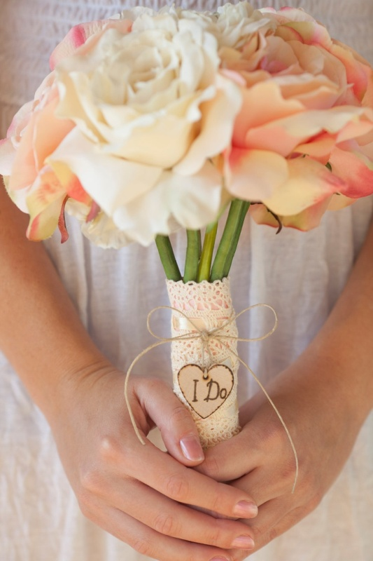 a lace wrap with twine and a small wooden heart that is wood burnt is a very cute rustic idea
