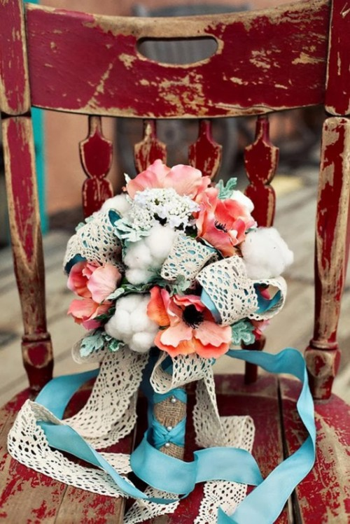 blue and white lace ribbons with a large bow is a cool idea for a rustic wedding bouquet