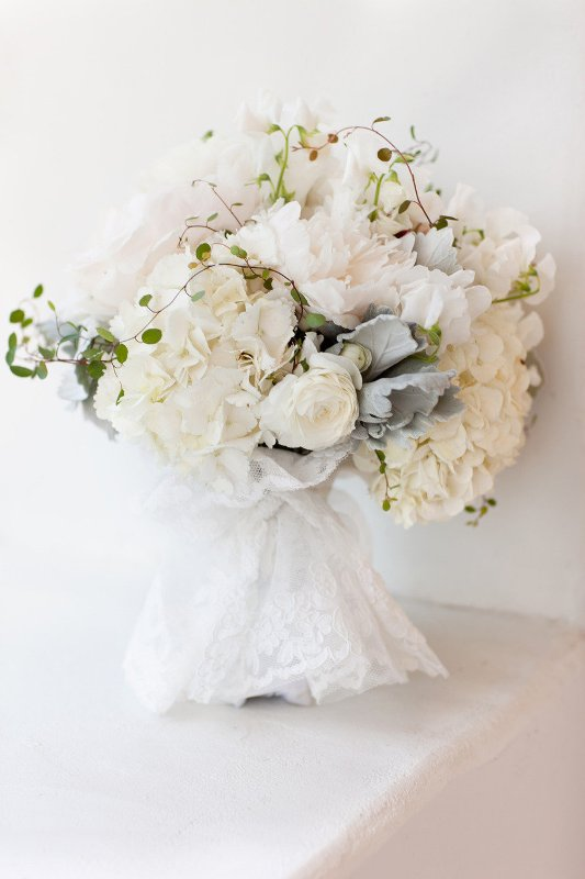 a white lace wrap will make your wedding bouquet really ethereal and very airy