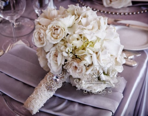 a super glam and shiny wedding bouquet wrap with pearls, beads and rhinestones
