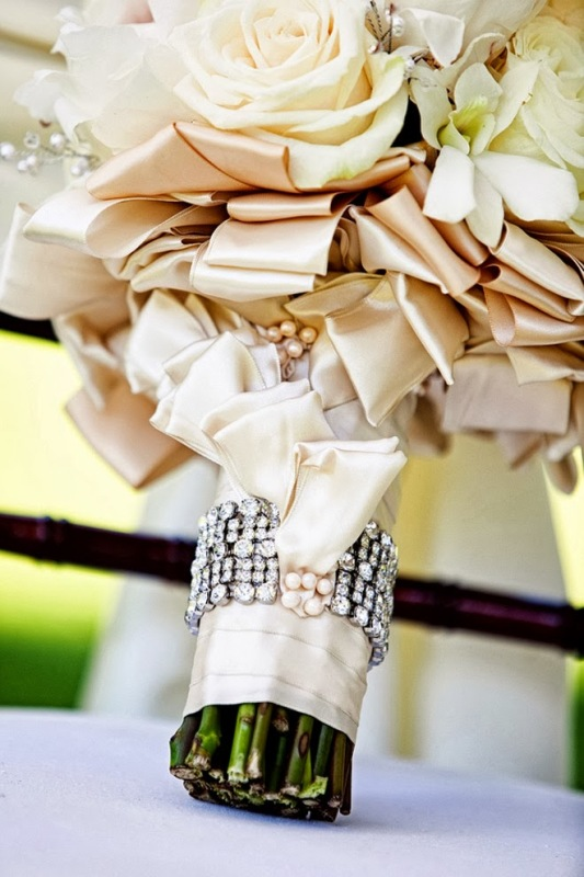 a ribbon wrap with a rhinestone accent is very refined, glam and cool