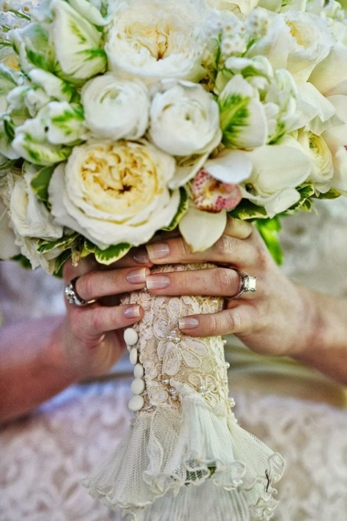 a lace and ruffle wedding bouquet wrap with buttons is amazing for a vintage-inspired wedding bouquet
