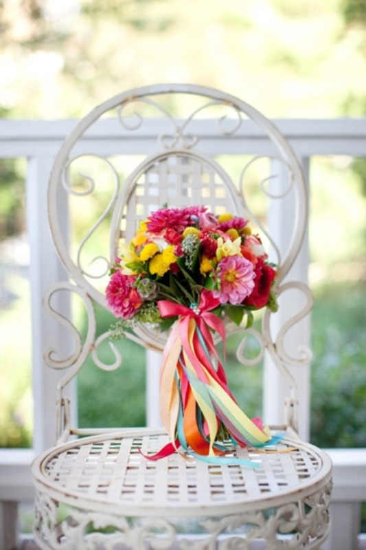 a colorful ribbon wrap and a bow with lots of ribbons is a fun and cute idea for a colorful summer wedding