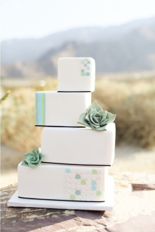 a stacked square wedding cake decorated with colorful dots and stripes plus sugar succulents is a lovely and fresh idea for a desert wedding