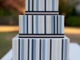 a square wedding cake with bold striped tiers and black edges is a bold and statement-like idea for a modern wedding