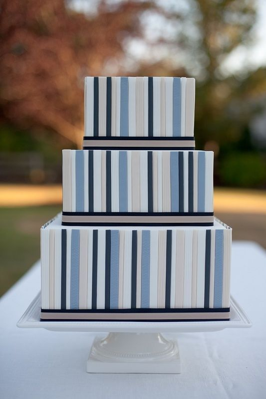 a square wedding cake with bold striped tiers and black edges is a bold and statement like idea for a modern wedding