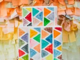 a bright square wedding cake with colorful triangles is a bold and cool idea for a mid-century modern wedding