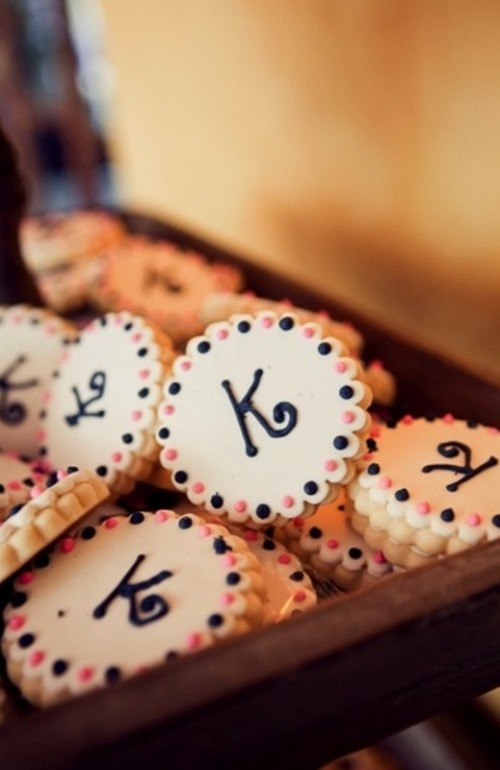 little scallop edge cookies with monograms and navy and coral pink dots are amazing desserts for a wedding sweets table