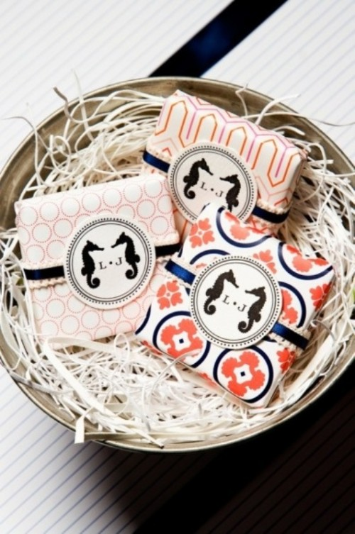 printed coral napkins with navy napkin rings and monograms are a very fun and cute idea