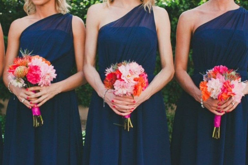 navy one shoulder maxi dresses fro bridesmaids and coral and hot red bouquets for a contrast