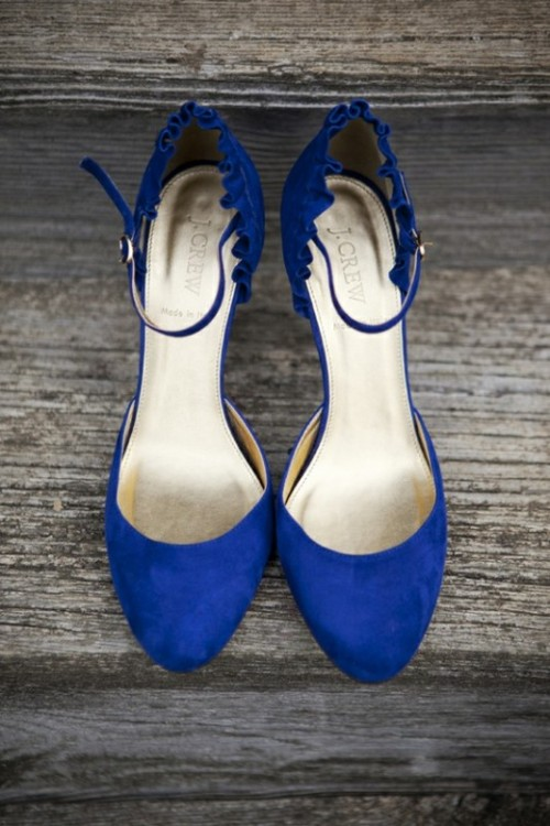 navy shoes with ankle straps and a scallop edge for a bold 'something blue' touch in the bridal look