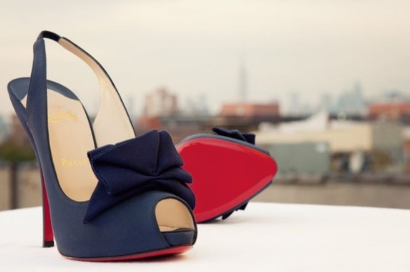 navy wedding shoes with bows and coral bottoms will help you keep the color scheme up